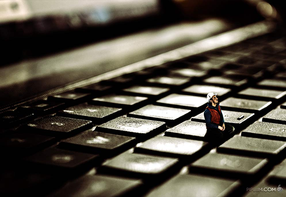 man-sitting-on-a-keyboard-Surreal-photography