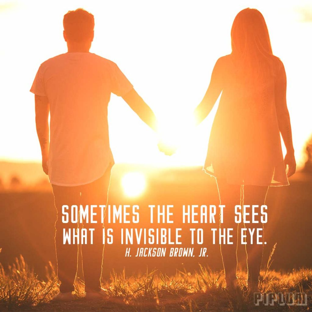 Love quote. Couple holding hands and looking to sunset together.