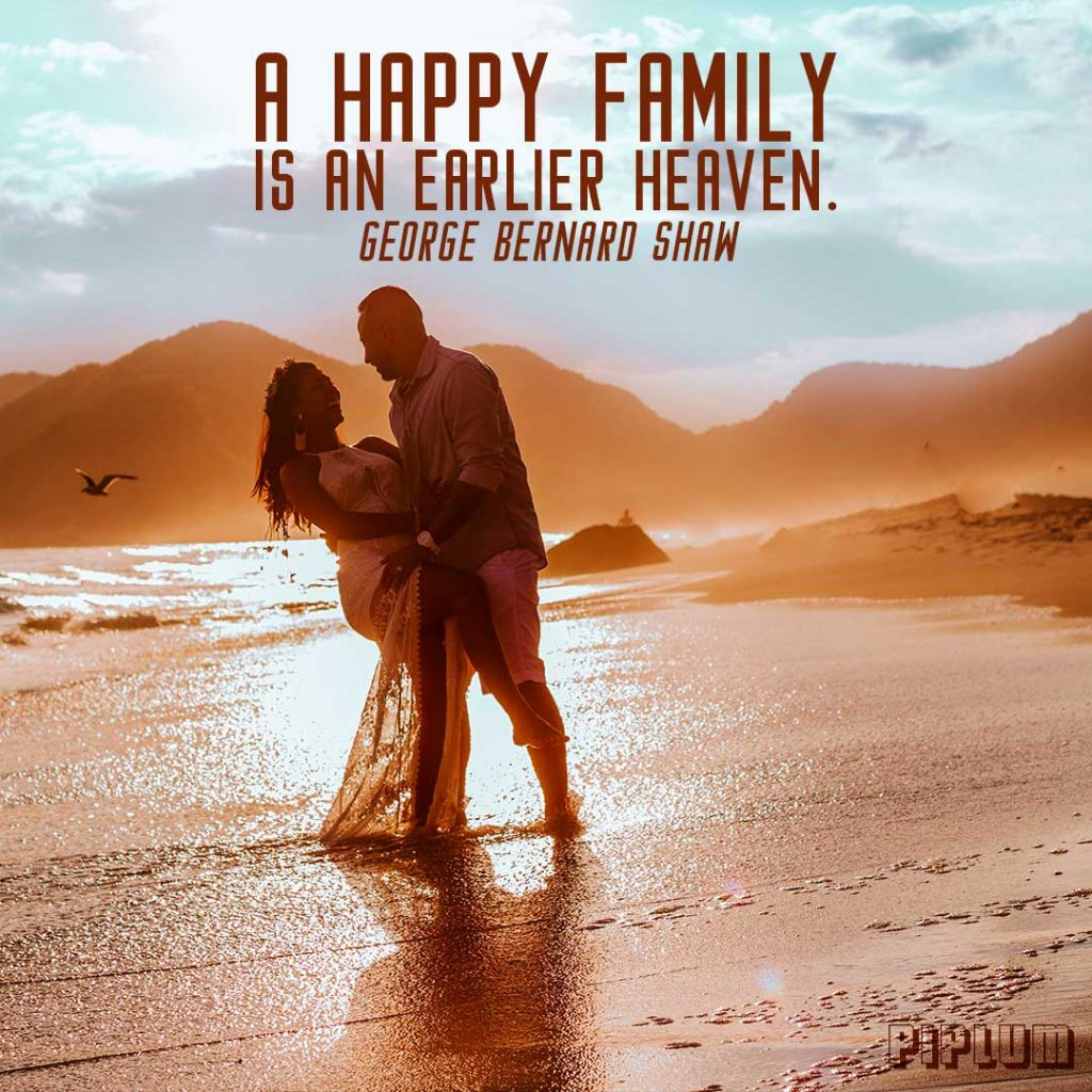 Family Quote. Just married couple kissing in the beach during sunset. They are feeling like in heaven