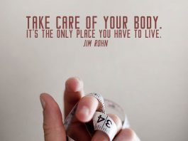 Workout quote. Waist measuring tape on hand.