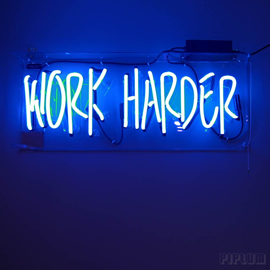 Work-harder-quote-Halogenated-light-on-the-wall.