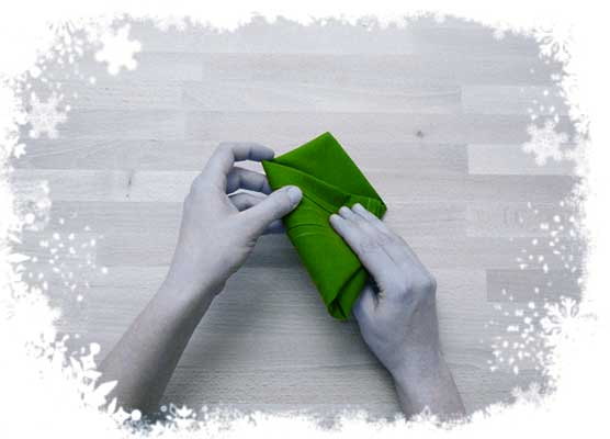 Christmas-tree-folding-tutorial-Flipping-back-the-cloth-Step-5.