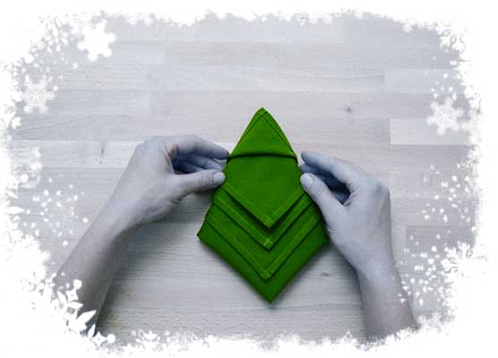 Christmas-tree-folding-tutorial-Hide-lower-layers-tips-underneath-the-upper-folds-Step-5.